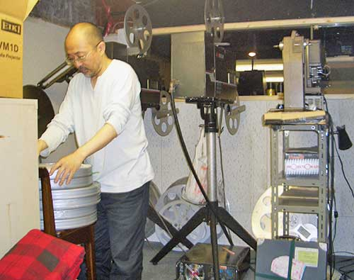 Kunihiko Tomioka in the projection room of Planet Studyo + 1