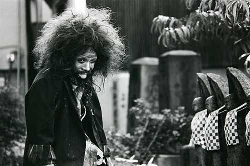 Noisy Requiem - Isamu Osuga as crazy homeless man