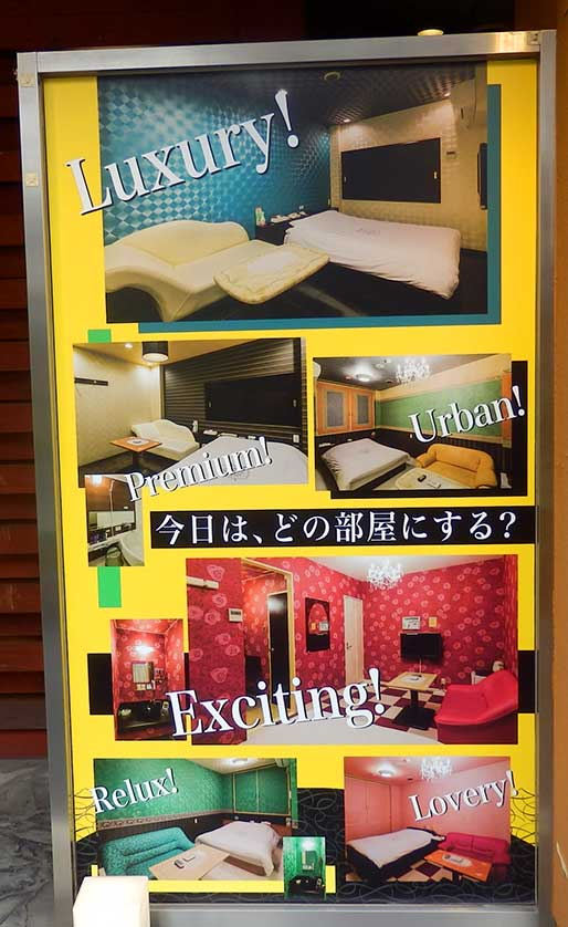 """Love Hotel room options. The sign reads """"Which room will it be today?""""."""